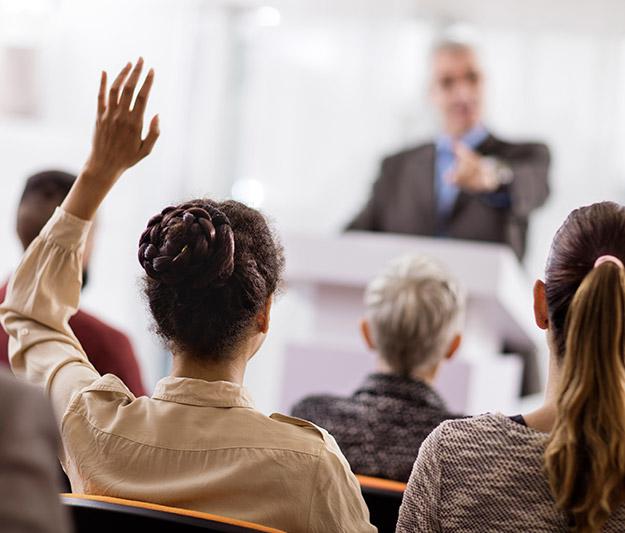 Female student raising hand
